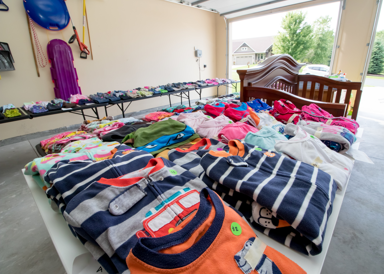 Garage-Sale-Clothes-on-Table