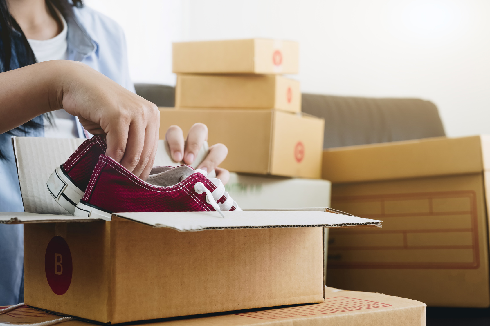 Woman-Packing-Shoes