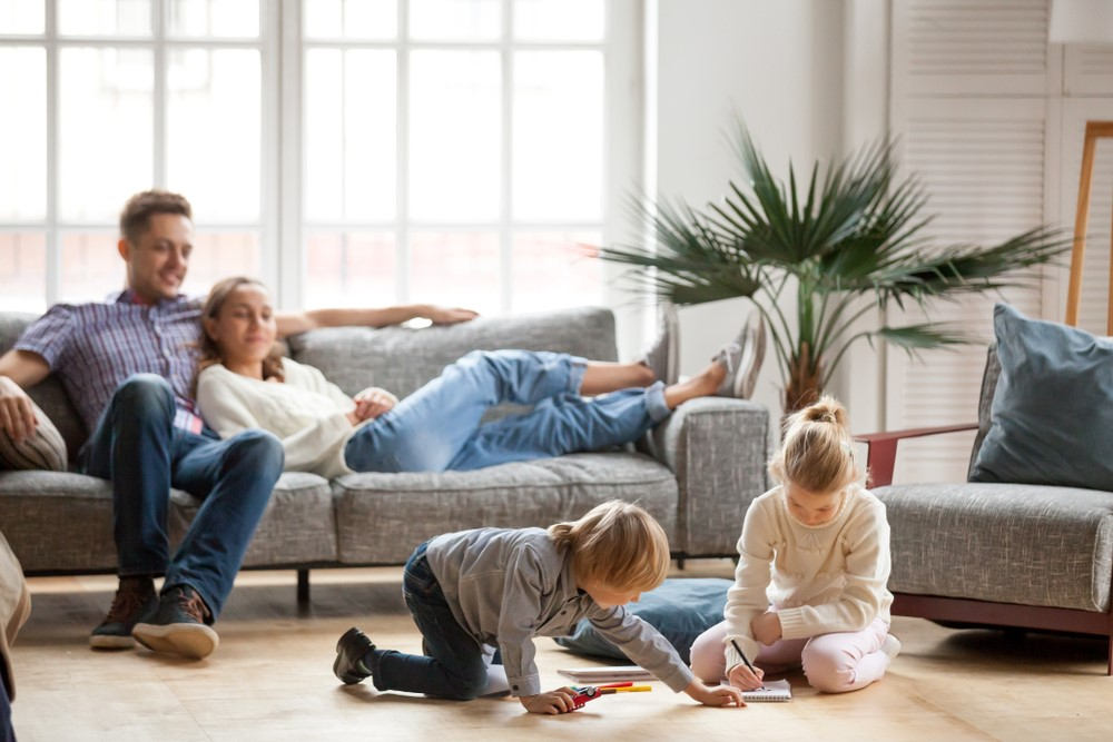 Children Playing While Parents Watch Sitting on the Couch