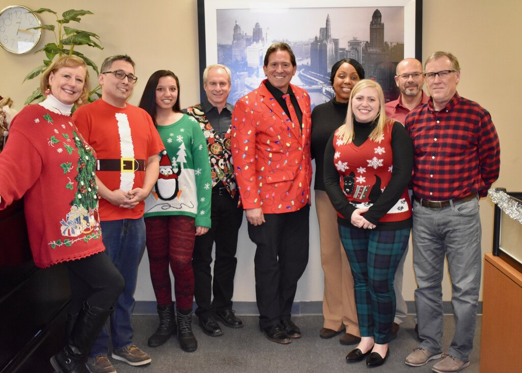 Mid-West Moving & Storage Team with Holiday Sweaters