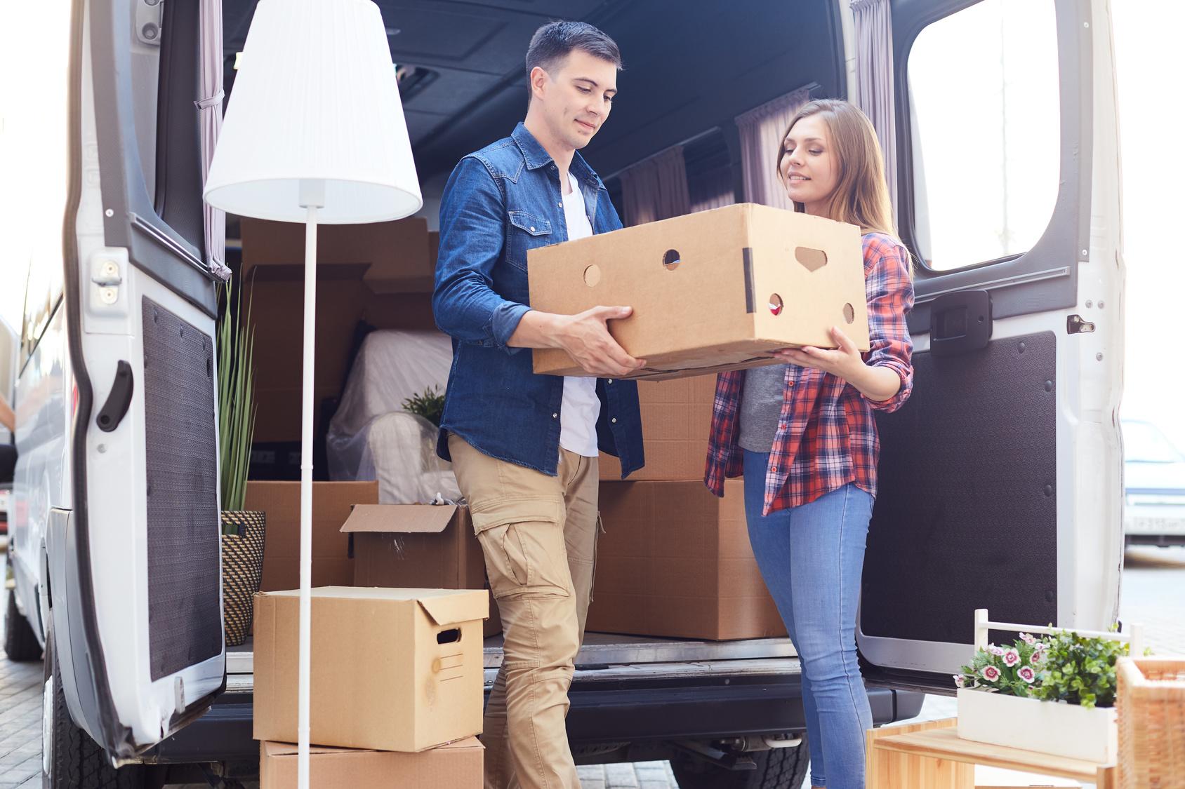 Young Couple Unloading Van