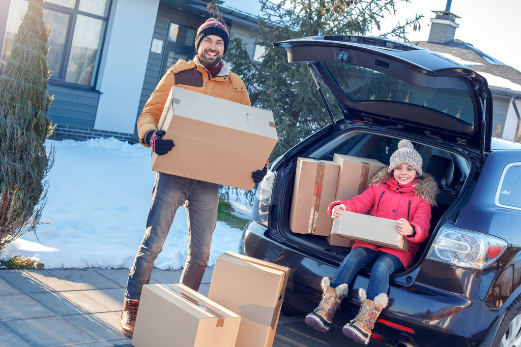 Family with Moving Boxes in Winter