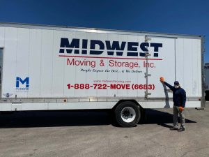 Luis Toledo with Mid-West Moving & Storage Truck