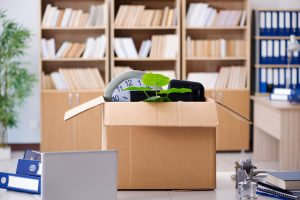 Box of Items on Desk