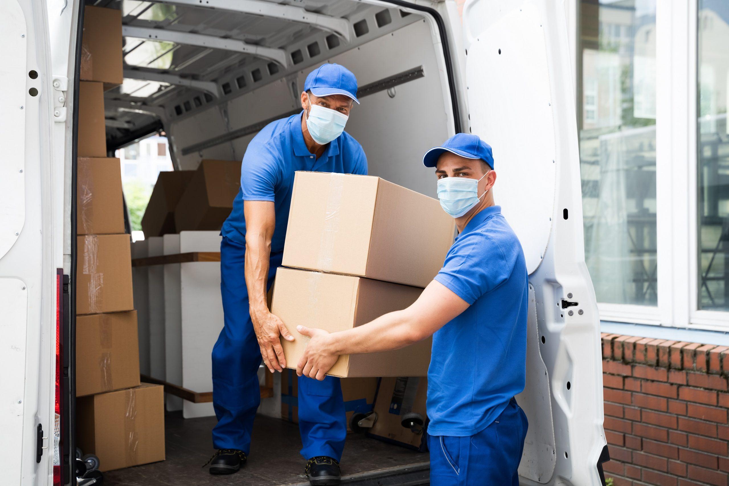 Men Unloading Cardboard Boxes